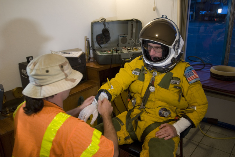 Dave Wright dons high-altitude pressure suit. | Operation ...