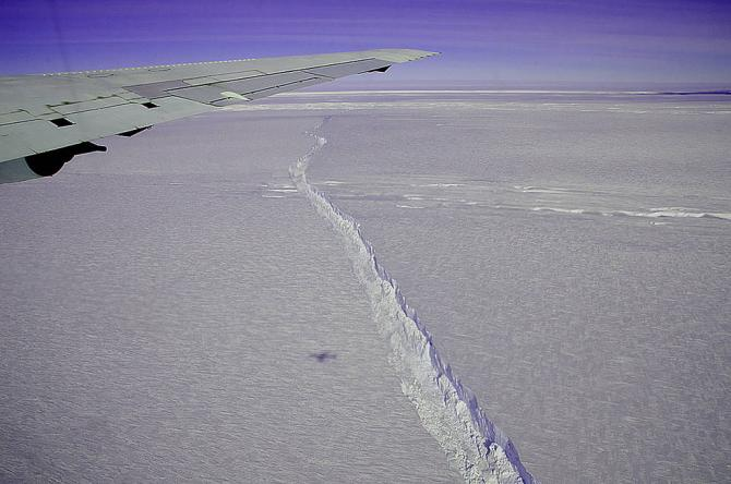 A photo from the window of NASA's DC-8 shows the rift across the Pine Island Glacier ice shelf running off toward the horizon. The plane flew across the crevasse on Oct. 26, 2011 as part of NASA's Operation IceBridge, and also flew directly over the rift for about 18 miles, taking detailed measurements of its depth, width and shape. The ice shelf hadn't calved a major iceberg since 2001, and IceBridge took advantage of the opportunity afforded by spotting the crack to fly over it and measure its characteris