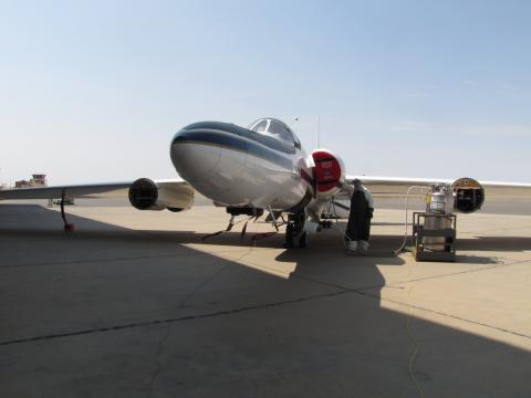 ER-2 mechanic loxing the plane