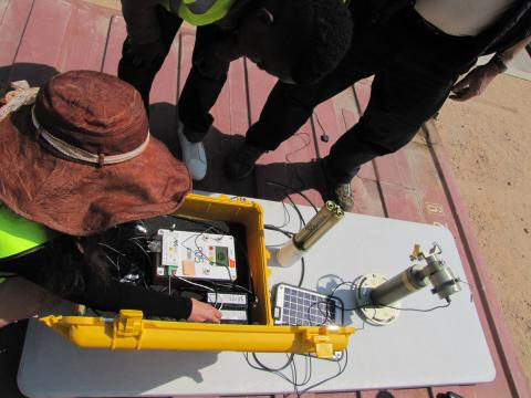 Assembling Cimel on top of the cargo container