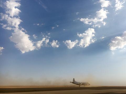 P-3 dusty arrival