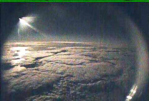 AV-6 nose camera view of moon over TS Nadine from 63,000 ft (9.27.12)