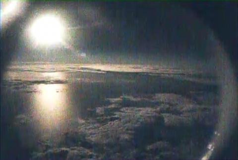 AV-6 nose camera view of moon over TS Nadine from 63,000 ft (9.27.12)