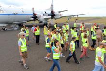 ORACLES team head back into the hangar after group photo. Sao Tome Intnl Airport