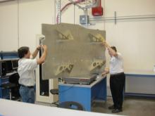 Weighing the S-HIS mounting plate (2011)