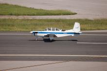 T-34 Chase Plane ready to accompany AV-6 Global Hawk coming in for landing at Wallops Flight Facility (2012)