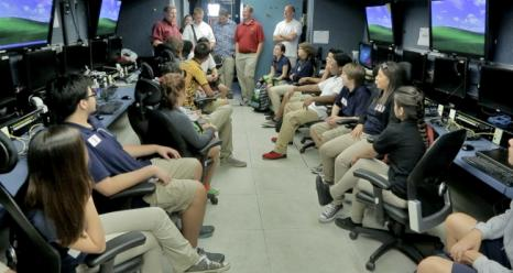 Students and teachers from Guam High School learn about how ATTREX scientists control their instruments on Global Hawk from the Payload Mobile Operations Facility.