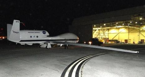 NASA's unmanned Global Hawk is pushed out of a hangar on Andersen Air Force Base, Guam, in preparation for an ATTREX science flight over the Western Pacific.